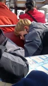 Europe Spring Break - Amsterdam: Quinn Sleeping oun the Canal Cruise